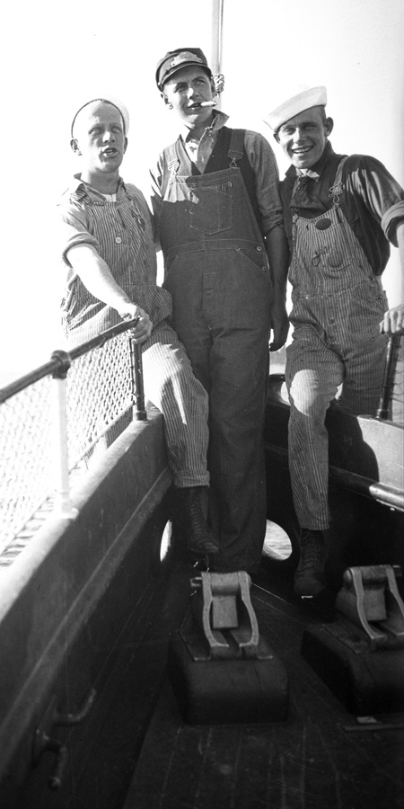 Three crewmen on the bow of the Steamer Tahoe
