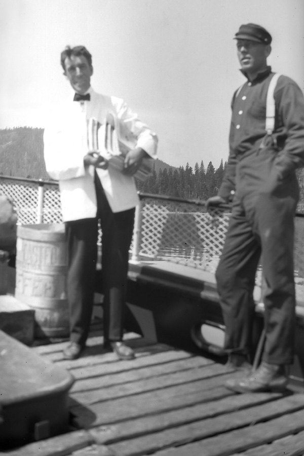 The porter and a deckhand on the deck of the Steamer Tahoe.