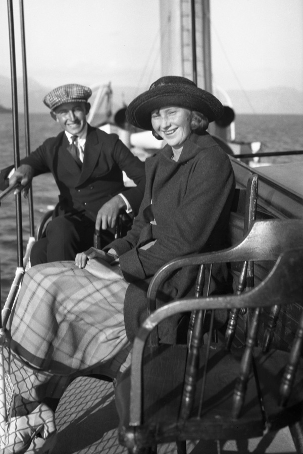 A young couple enjoying the view from the upper deck of the Steamer Tahoe.