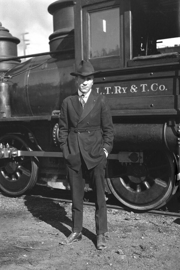 Man in front of locomotive